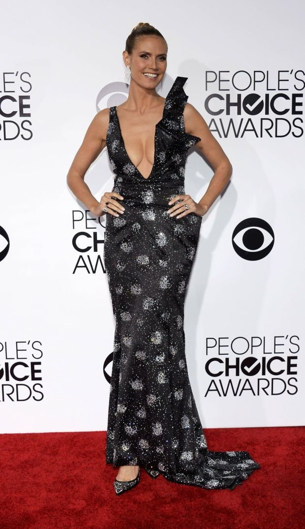 "Model Heidi Klum, host of ""Project Runway"" arrives at the 2014 People's Choice Awards in Los Angeles, California January 8, 2014. REUTERS/Kevork Djsnsezian (UNITED STATES-TAGS: ENTERTAINMENT) (PEOPLESCHOICE-ARRIVALS)"