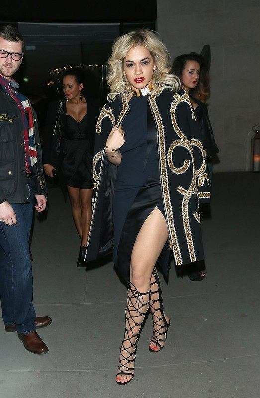Singer Rita Ora is seen here leaving the ME Hotel in London after attending a LFW show. Rita looked stunning in a pair of knee high lace high heels, a navy blue leg split dress with a gold and navy blue jacket and a large gold necklace.  Pictured: Rita Ora