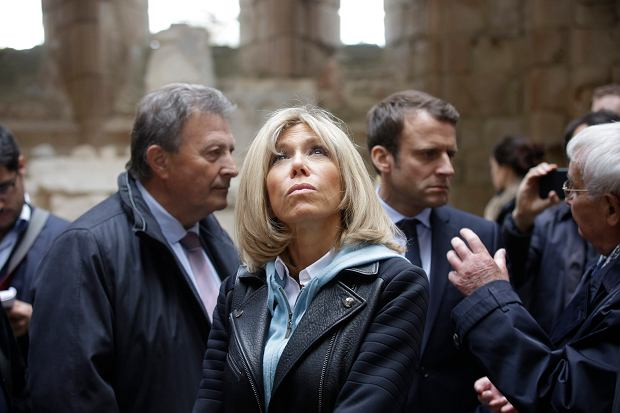 French independent centrist presidential candidate Emmanuel Macron, 2nd right, and his wife Brigitte Macron, visit the French martyr village of Oradour-sur-Glane, central France, Friday, April 28, 2017. France's troubled wartime past is taking center stage Friday in the country's highly charged presidential race, as centrist Emmanuel Macron visited the site of France's worst Nazi massacre and Marine Le Pen's far-right party suffered a new blow over alleged Holocaust denial. (Pascal Lachenaud/Pool Photo via AP)