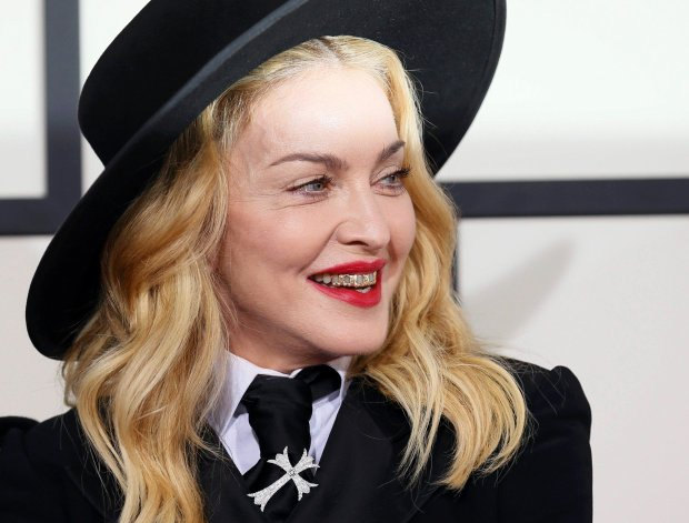 Madonna arrives at the 56th annual Grammy Awards in Los Angeles, California January 26, 2014.     REUTERS/Danny Moloshok (UNITED STATES TAGS: ENTERTAINMENT) (GRAMMYS-ARRIVALS)