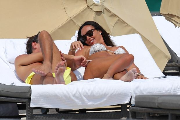 Billionaire heiress and reality television star Tamara Ecclestone, 28, is seen sunbathing with her boyfriend at the beach in Miami, FL.  Pictured: Tamara Ecclestone and Jay Rutland