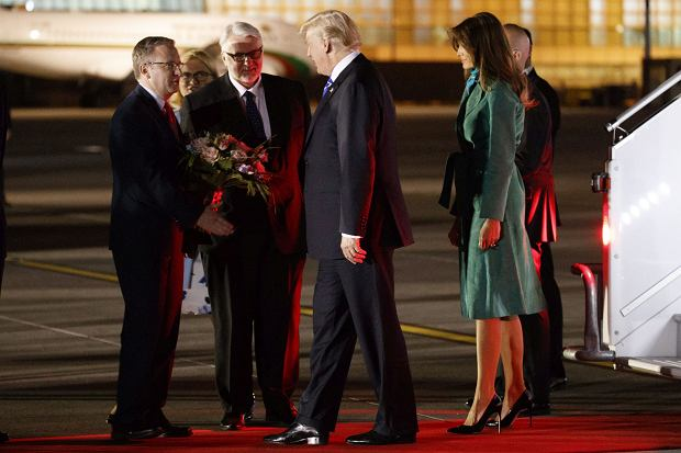President Donald Trump and first lady Melania Trump are greeted by Polish Minister of State Krzysztof Szczerski, left, and Polish Foreign Minister Witold Waszczykowski after arriving at Warsaw Chopin Airport, Wednesday, July 5, 2017, in Warsaw. (AP Photo/Evan Vucci)