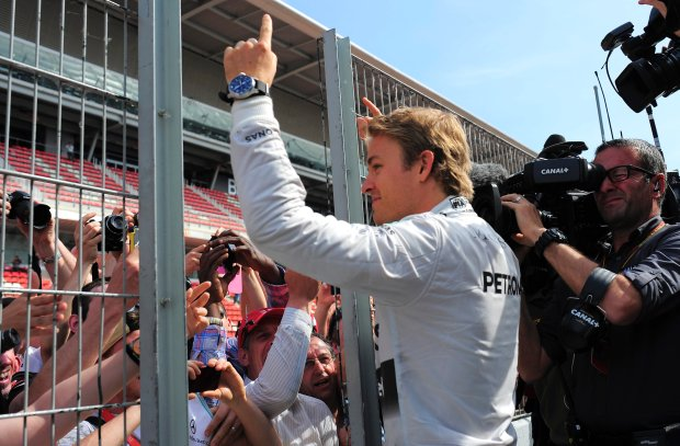 Mercedes driver Nico Rosberg of Germany celebrates with supporters his second position at the end of the Spain Formula One Grand Prix at the Barcelona Catalunya racetrack in Montmelo, near Barcelona, Spain, Sunday, May 11, 2014.(AP Photo/Manu Fernandez)