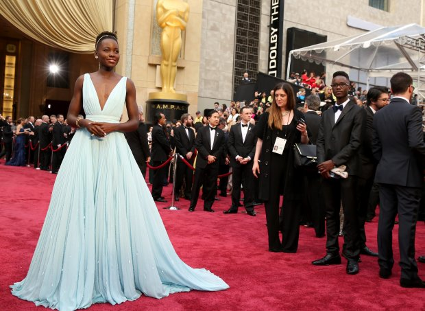 Lupita Nyong'o arrives at the Oscars on Sunday, March 2, 2014, at the Dolby Theatre in Los Angeles.  (Photo by Matt Sayles/Invision/AP)