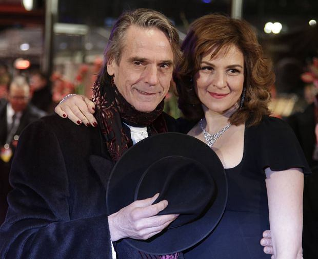 """Actors Jeremy Irons and Martina Gedeck arrive on the red carpet for the screening of the movie """"Night Train to Lisbon"""" at the 63rd Berlinale International Film Festival in Berlin February 13, 2013.  REUTERS/Tobias Schwarz (GERMANY - Tags: ENTERTAINMENT)"""