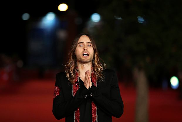 Cast member Jared Leto gestures as he arrives for a red carpet event for the movie