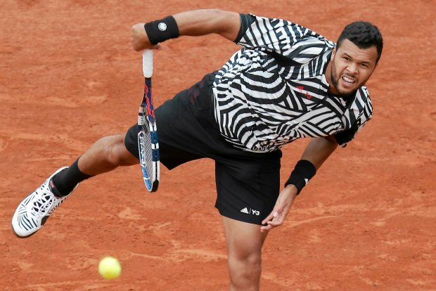 France's Jo-Wilfried Tsonga serves in his first round match of the French Open tennis tournament against Germany's Jan-Lennard Struff at the Roland Garros stadium in Paris, France, Tuesday, May 24, 2016. (AP Photo/Michel Euler)