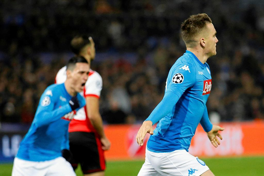 Napoli's Piotr Zielinski, right, celebrates scoring the opening goal during a Champions League Group F soccer match between Feyenoord and Napoli at the Kuip stadium in Rotterdam