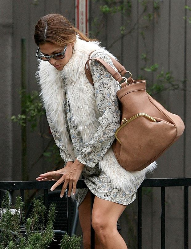 EXCLUSIVE: Actress Eva Mendes proves that even stars hop over fences, in heels and short skirts! The Latin star was faced with a dilemma as she headed out for breakfast in West Hollywood,Ca when a section of the sidewalk was closed. The only way round was to hike up her skirt and jump the fence!   Pictured: Eva Mendes