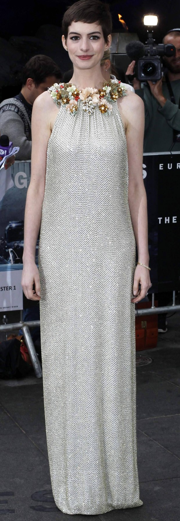 """U.S. actress Anne Hathaway poses for photographers as she arrives at the European Premiere of """"The Dark Knight Rises"""" in Leicester Square, central London, July 18, 2012. REUTERS/Andrew Winning (BRITAIN - Tags: ENTERTAINMENT)"""