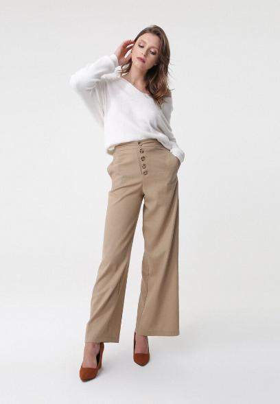 Beżowe i białe spodnie. Śliczne modele w najmodniejszych
