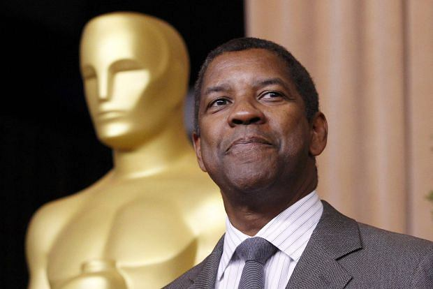 """Denzel Washington, nominated for best actor for his role in """"Flight"""", arrives   at the 85th Academy Awards nominees luncheon in Beverly Hills, California February 4, 2013.   REUTERS/Mario Anzuoni (UNITED STATES  - Tags: ENTERTAINMENT)"""