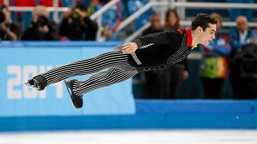 Oto najlepsze zdjęcia z 2014 roku przedstawiające sportowców w locie.<br> Hiszpan Javier Fernandez wykonuje program krótki podczas zawodów łyżwiarzy figurowych na igrzyskach w Soczi
