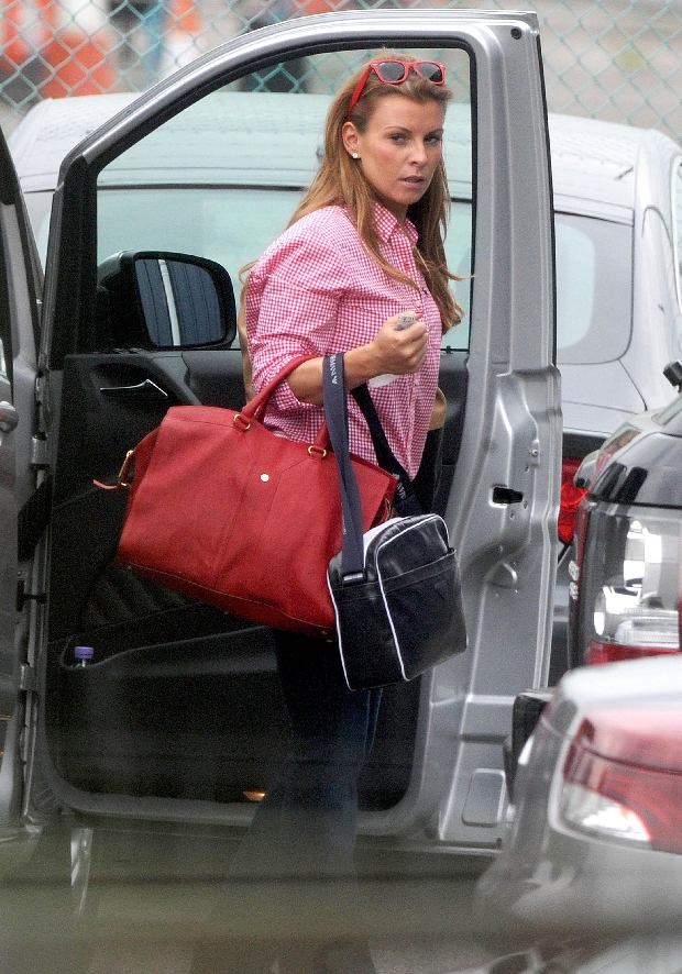 June 13, 2012 - Liverpool, Merseyside, United Kingdom - England WAG COLEEN ROONEY, the wife of England striker W. Rooney, arriving at Liverpool John Lennon Airport en route to Poland for the Euros. (Credit Image: ? Mercury Press/ZUMAPRESS.com)