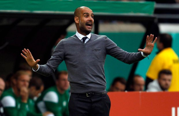 Bayern Munich's coach Pep Guardiola gestures during their German soccer cup (DFB Pokal) first round soccer match against Preussen Muenster in Muenster August 17, 2014. REUTERS/Ina Fassbender(GERMANY - Tags: SPORT SOCCER) DFB RULES PROHIBIT USE IN MMS SERVICES VIA HANDHELD DEVICES UNTIL TWO HOURS AFTER A MATCH AND ANY USAGE ON INTERNET OR ONLINE MEDIA SIMULATING VIDEO FOOTAGE DURING THE MATCH SLOWA KLUCZOWE: :rel:d:bm:GF2EA8H15I801
