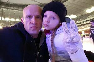 Tomasz Oświeciński z córką