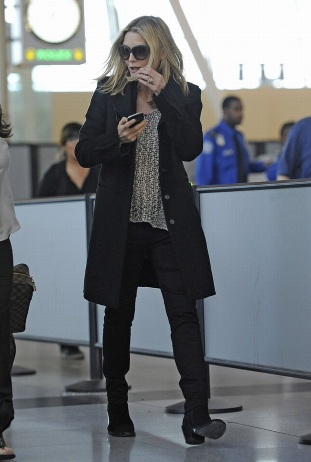 Michelle Pfeiffer walks through JFK Airport in New York after arriving on a flight from San Francisco.  Pictured: Michelle Pfeiffer
