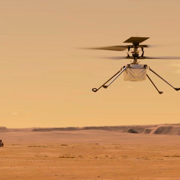 Ilustracja udostępniona przez NASA przedstawia helikopter Ingenuity na Marsie, który został przymocowany do dna łazika Perseverance