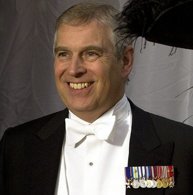 Britain's Prince Andrew, centre, waits with the Lord Mayor of London Roger Gifford, right, for the arrival of the The Amir of Kuwait Sheikh Sabah Al Ahmed Al Sabah,  for the Guildhall banquet in the City of London Wednesday, Nov.  28, 2012. (AP Photo/Alastair Grant   )