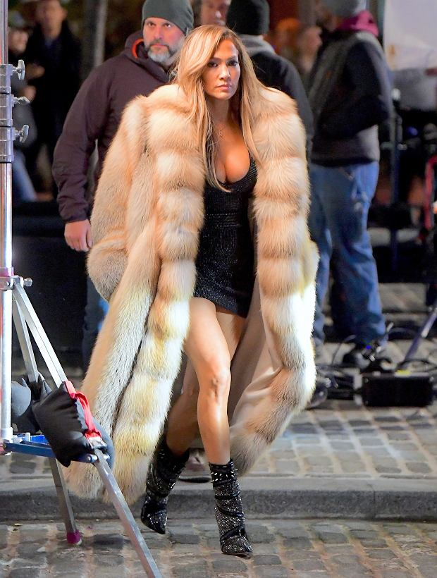 EXCLUSIVE: Jennifer Lopez was spotted filming scenes for her new movie Hustlers, late into the night on Friday. She wore a very short LBD, showing off her amazing physique, with an extravagant floor length fur coat. She filming with co-star Constance Wu, in the Meatpacking District until nearly 4am. In one scene she stopped to pose for a photo with her signature smize .    Pictured: Jennifer Lopez      World Rights, No Portugal Rights