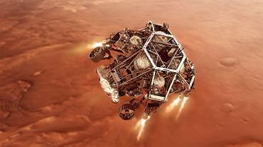 Grafika NASA przedstawiająca łazik w ostatniej fazie lądowania, podczas działania rakietowej platformy