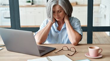 HTired,Stressed,Old,Mature,Business,Woman,Suffering,From,Neckpain,Working