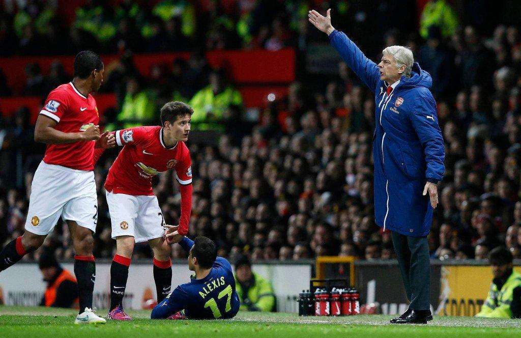 Arsene Wenger i zawodnicy Manchesteru United