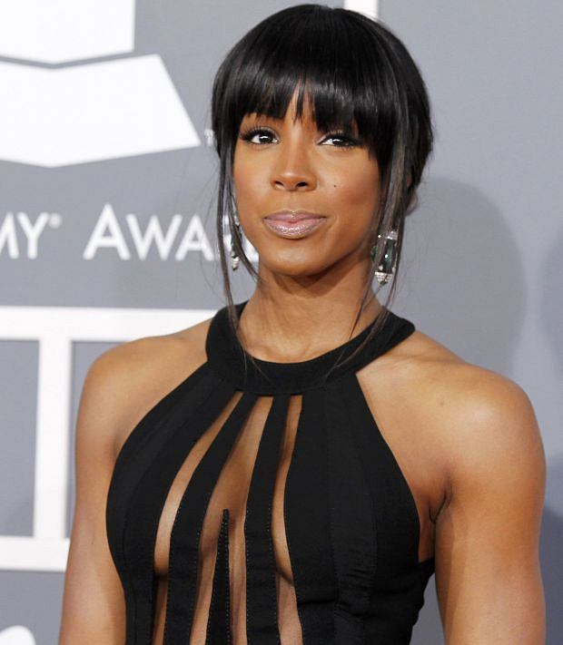 Recording artist Kelly Rowland arrives at the 55th annual Grammy Awards in Los Angeles, California February 10, 2013.  REUTERS/Mario Anzuoni (UNITED STATES  - Tags: ENTERTAINMENT)  (GRAMMYS-ARRIVALS)