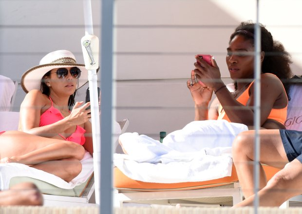 EXCLUSIVE TO INF. April 5, 2015: Eva Longoria and Serena Williams show off their assets in brightly colored bikinis poolside in Miami Beach. Serena taking some time to relax following her Miami Open win yesterday. Eva was with boyfriend Jose Antonio Baston, and the two were seen using a selfie stick to take pictures of themselves. Scottie Pippen and some friends stopped by and said hello. Mandatory Credit: INFphoto.com Ref: infusmi-11/13