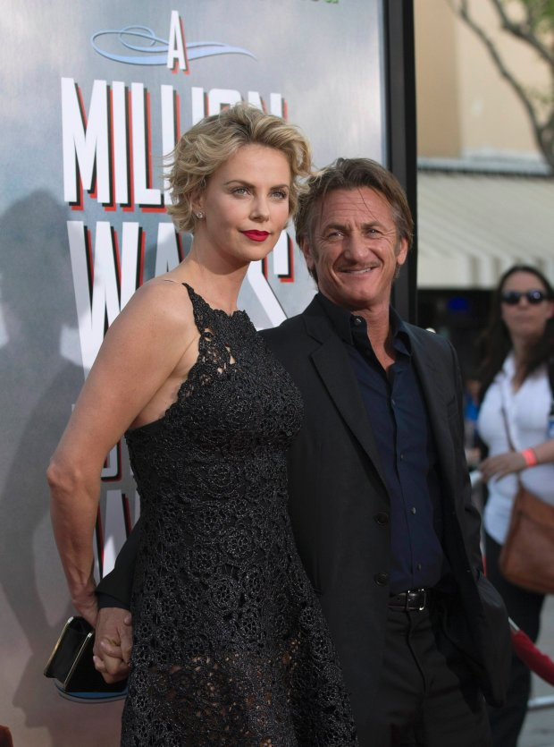 "Cast member Charlize Theron and actor Sean Penn pose at the premiere of ""A Million Ways to Die in the West"" in Los Angeles, California May 15, 2014. The movie opens in the U.S. on May 30.   REUTERS/Mario Anzuoni  (UNITED STATES - Tags: ENTERTAINMENT)"