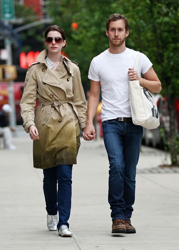 Anne Hathaway and her boyfriend Adam Shulman were spotted out and about in the streets of NYC, her beau Adam toted a bag with a picture of Stephen Colbert, and Anne wore her favorite Burberry trench coat.  Pictured: Anne Hathaway and Adam Shulman  Ref: SPL103545  290509  Picture by: Saleem Elatab-AhmadElatab / Splash News     World Rights