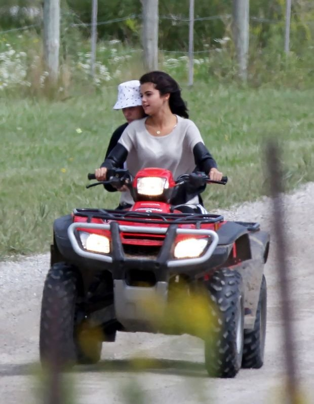 125112, PREMIUM EXCLUSIVE: Justin Bieber and Selena Gomez rekindle their relationship with an ATV ride through Stratford, Canada. The two arrived on Wednesday on a private jet from LA. Later they are spotted riding an ATV in Stratford where his dad lives. Both Justin and Selena were not wearing helmets which is required by law in Canada. Also, ATVs are not allowed on pubic roads. Justin was seen showing Selena how to drive it and let her take the controls first. The two switched on the way back to his dads house. Stratford, Canada - Friday August 29, 2014. CANADA OUT Photograph: ? ONeill/Todd G, PacificCoastNews. Los Angeles Office: +1 310.822.0419 London Office: +44 208.090.4079 sales@pacificcoastnews.com FEE MUST BE AGREED PRIOR TO USAGE