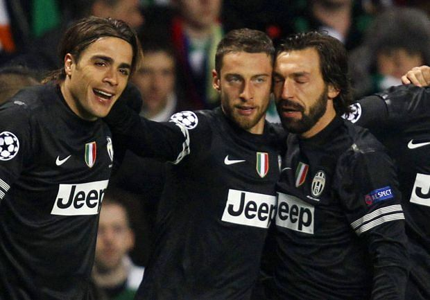 Juventus' Alessandro Matri (L) celebrates with his team mates Claudio Marchisio (C) and Andrea Pirlo after they scored their first goal against Celtic during their Champions League soccer match at Celtic Park stadium in Glasgow, Scotland February 12, 2013. REUTERS/David Moir (BRITAIN - Tags: SPORT SOCCER)