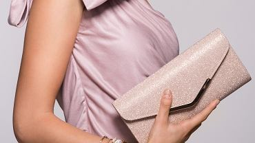 >Young,Beautiful,Woman,In,Elegant,Pink,Dress,Holding,Clutch,And