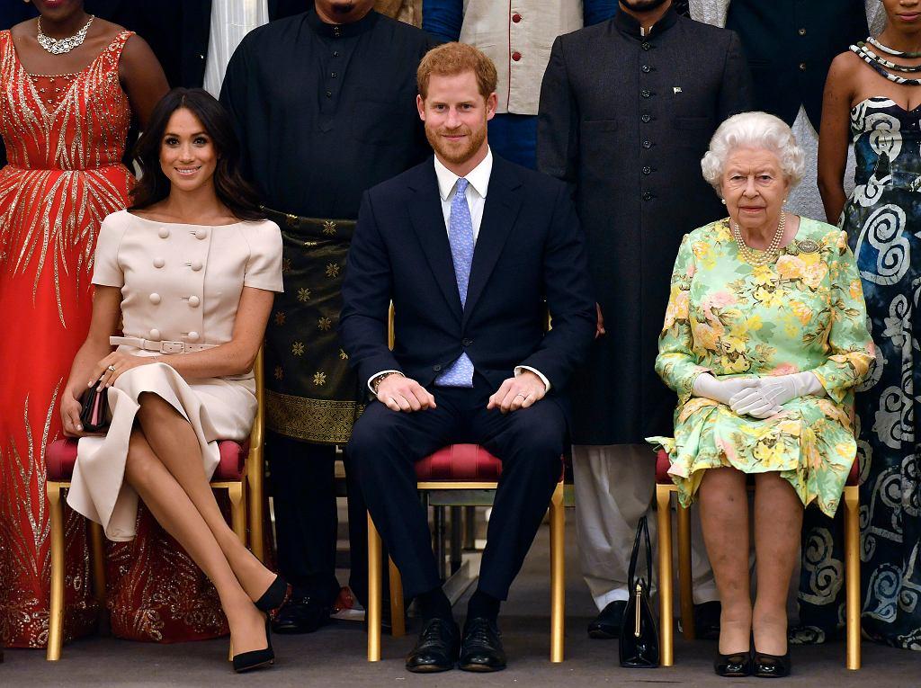 Królowa Elżbieta II, książę Harry i Meghan Markle