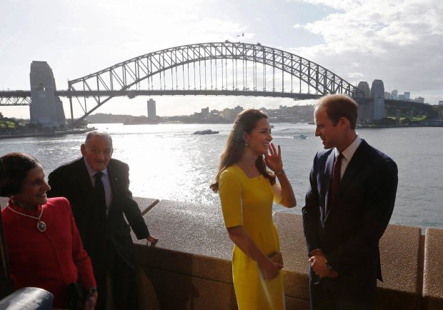 Britain's Prince William and his wife Catherine, the Duchess of Cambridge, are pictured in front of the Sydney Harbour Bridge during a reception at the Sydney Opera House, April 16, 2014. Pictured at left are Governor of New South Wales Marie Bashir and her husband Nicholas Shehadie. Britain's Prince William and his wife Kate are undertaking a 19-day official visit to New Zealand and Australia with their son George. REUTERS/Jason Reed (AUSTRALIA - Tags: ROYALS ENTERTAINMENT POLITICS)