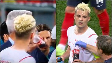 Granit Xhaka pije Coca Colę podczas przerwy przed dogrywką w meczu 1/8 finału Euro 2020 przeciwko Francji