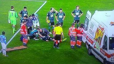 Damien Perquis leży nieprzytomny na murawie w meczu z Malagą