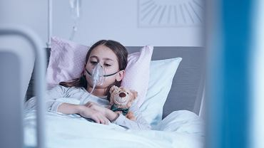 <Sick,Child,With,Oxygen,Mask,During,Treatment,In,The,Hospital
