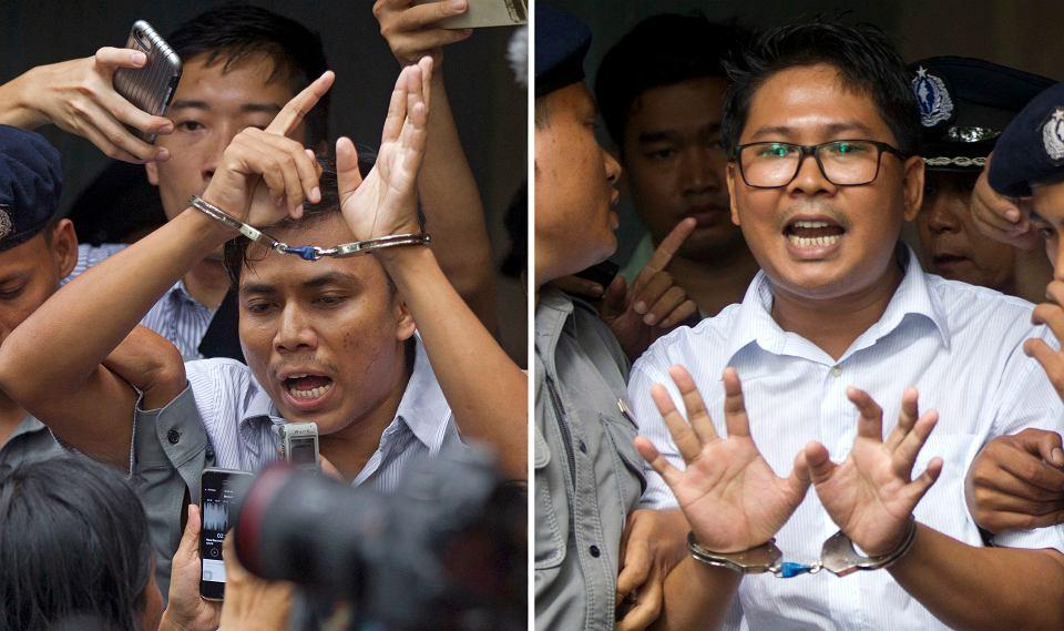 Dziennikarze agencji Reuters - Kyaw Soe Oo (z lewej) i Wa Lone - eskortowani przez policję opuszczają gmach sądu w Rangunie, 3 września 2018 r.
