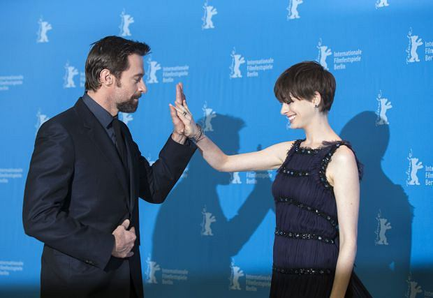 Actors Hugh Jackman, left, and Anne Hathaway joke around during a photo call of the film Les Miserables at the 63rd edition of the Berlinale, International Film Festival in Berlin, Germany, Saturday, Feb. 9, 2013. (AP Photo/Gero Breloer)