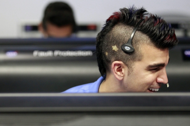 Activity lead Bobak Ferdowsi, who cuts his hair differently for each mission, works inside the Spaceflight Operations Facility for NASA's Mars Science Laboratory Curiosity rover at Jet Propulsion Laboratory (JPL) in Pasadena, Calif. on Sunday, Aug. 5, 2012. The Curiosity robot is equipped with a nuclear-powered lab capable of vaporizing rocks and ingesting soil, measuring habitability, and potentially paving the way for human exploration. (AP Photo/Los Angeles Times, Brian van der Brug, Pool)