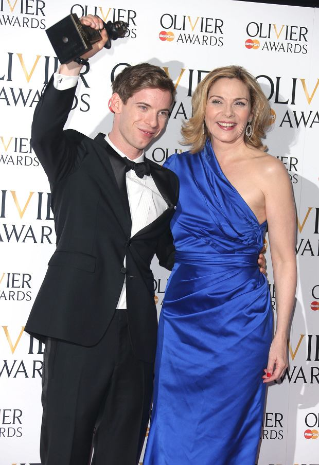 Luke Treadaway, winner of Best Actor Award for The Curious Incident of the Dog in the Night-time and Kim Cattrall  in the press room at the Olivier Awards 2013 at the Royal opera House in London on Sunday, April 28th, 2013. (Photo by Joel Ryan/Invision/AP)
