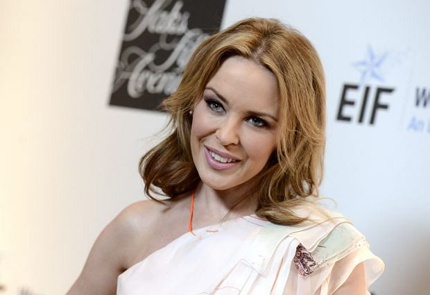 """Singer Kylie Minogue arrives at """"An Unforgettable Evening"""" benefiting EIF's Women's Cancer Research Fund at The Beverly Wilshire on Thursday, May 2, 2013, in Beverly Hills, Calif. (Photo by Dan Steinberg/Invision/AP)"""
