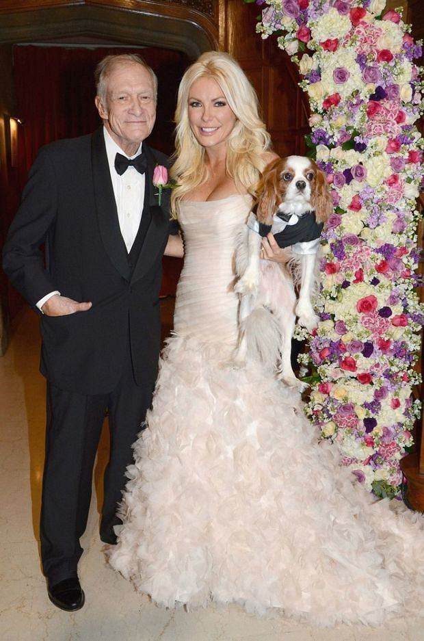 31/12/2012  Los Angeles  (USA)  Hugh Hefner and his new wife Crystal Harris pose in their official wedding portraits on New Year's Eve Monday (December 31) at the Playboy Mansion in Los Angeles.  The bride wore a floor length strapless gown in soft pink, the groom wore a traditional black tuxedo. The ceremony was followed by a private reception where they toasted with champagne and cut the wedding cake,