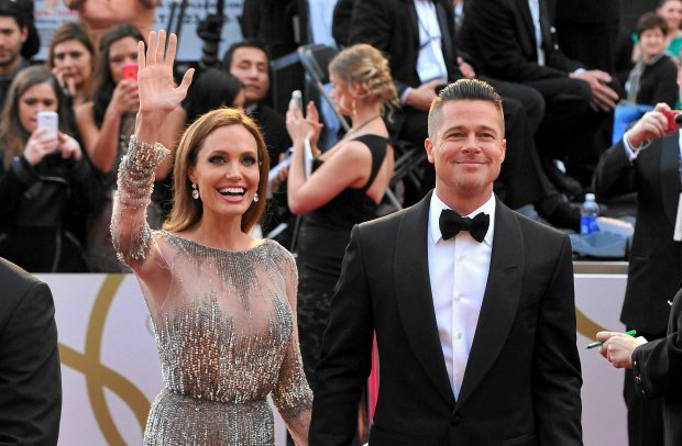 Angelina Jolie, left, and Brad Pitt arrive at the Oscars on Sunday, March 2, 2014, at the Dolby Theatre in Los Angeles.  (Photo by Vince Bucci/Invision/AP)