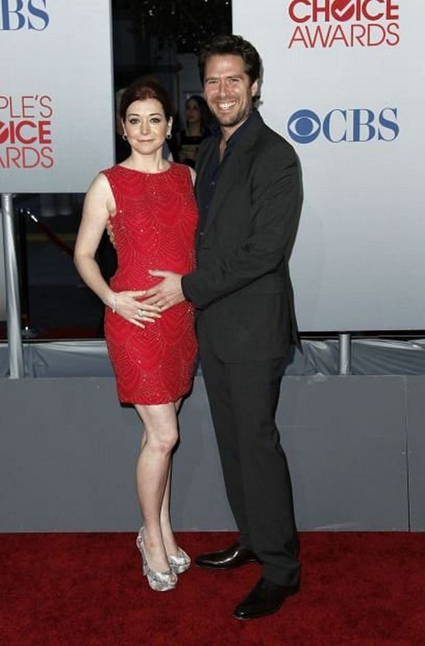 Alyson Hannigan, left, and Alexis Denisof arrive at the People's Choice Awards on Wednesday, Jan. 11, 2012 in Los Angeles. (AP Photo/Matt Sayles)