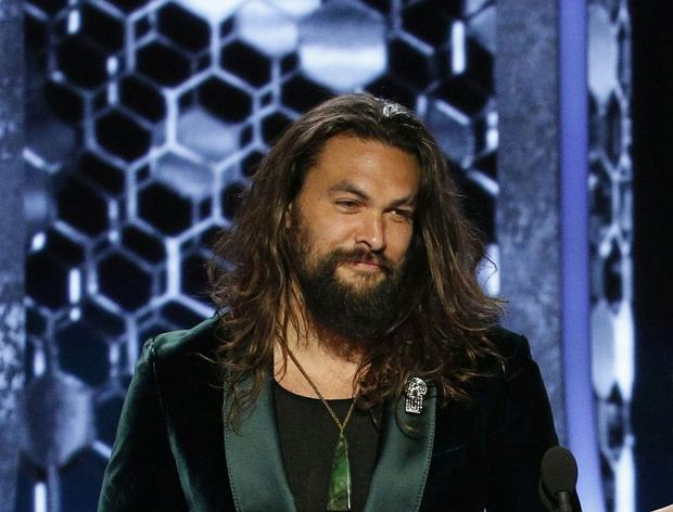 This image released by NBC shows presenters Jason Momoa, left, and Zoe Kravitz at the 77th Annual Golden Globe Awards at the Beverly Hilton Hotel in Beverly Hills, Calif., on Sunday, Jan. 5, 2020. (Paul Drinkwater/NBC via AP)