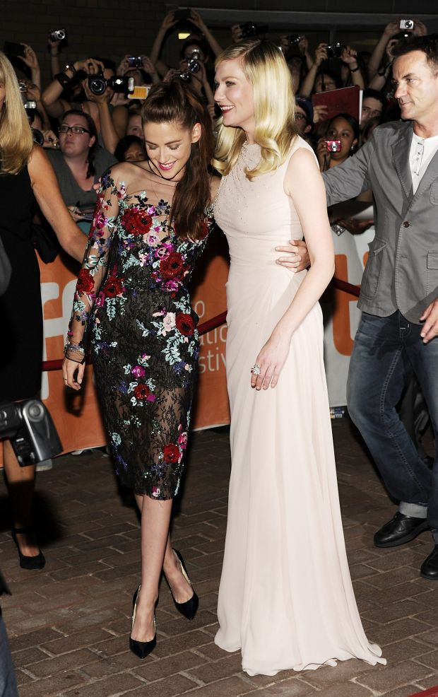 """Actresses Kristen Stewart, left, and Kirsten Dunst are shown at the gala premiere for """"On the Road"""" during the Toronto International Film Festival on Thursday Sept. 6, 2012 in Toronto. (Photo by Evan Agostini/Invision/AP)"""
