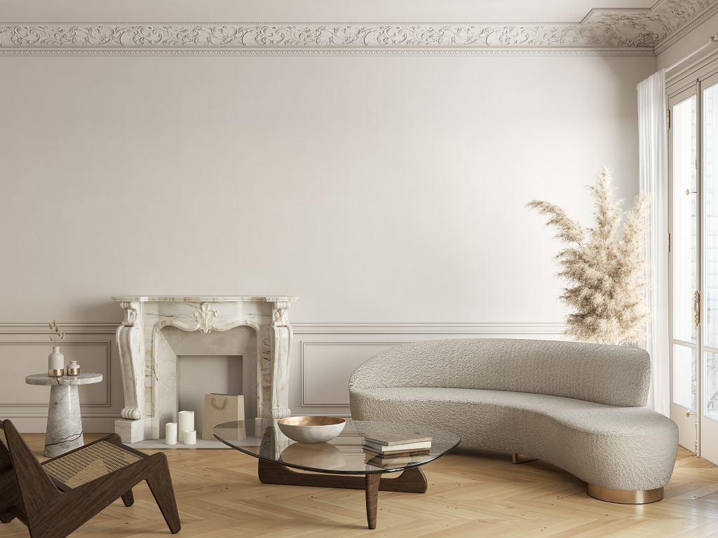 Szykowny salon ozdobiony stylowymi meblami.